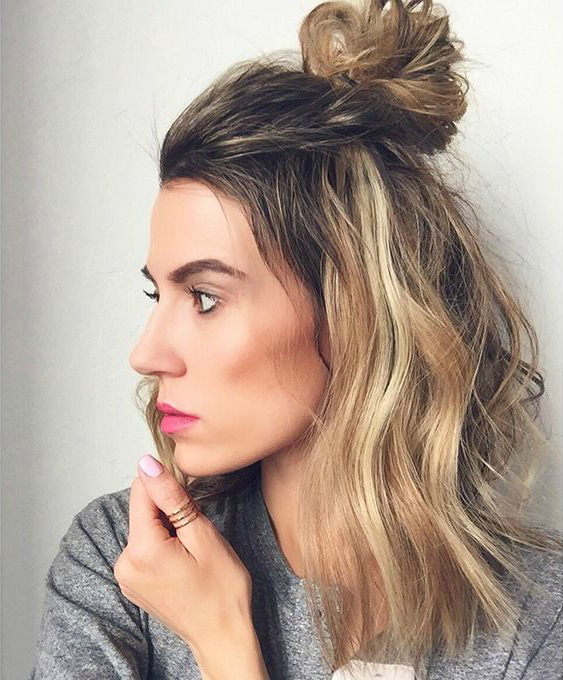 Some teasing can get a bigger, messier knot on shorter hair, via Pinterest